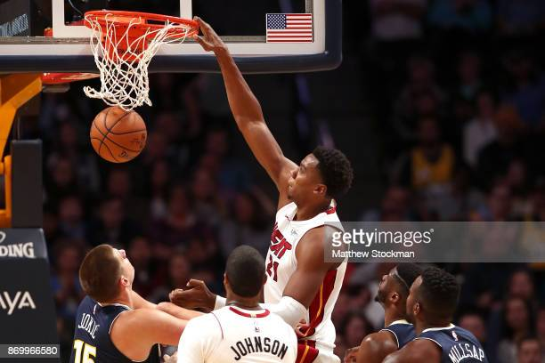 Hassan Whiteside of the Miami Heat dunks the ball against the Denver Nuggets at the Pepsi Center on November 3 2017 in Denver Colorado NOTE TO USER...