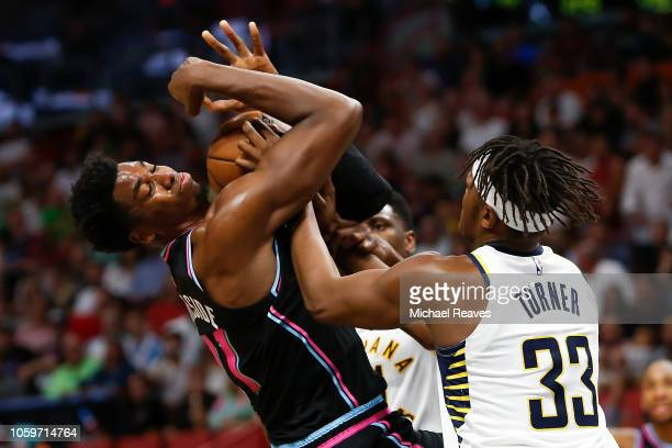 Hassan Whiteside of the Miami Heat fights for a loose ball with Myles Turner of the Indiana Pacers during the first half at American Airlines Arena...