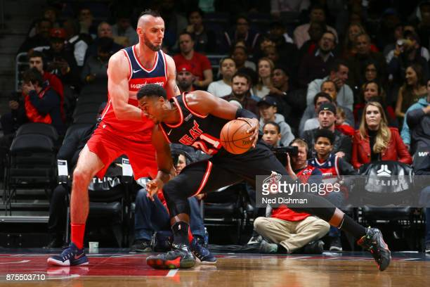 Hassan Whiteside of the Miami Heat handles the ball against the Washington Wizards on November 17 2017 at Capital One Arena in Washington DC NOTE TO...
