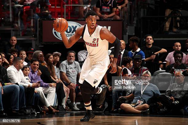 Hassan Whiteside of the Miami Heat handles the ball during the game against the Dallas Mavericks on January 19 2017 at AmericanAirlines Arena in...
