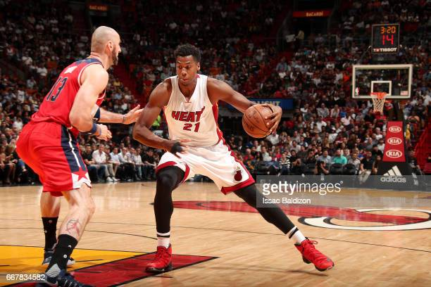 Hassan Whiteside of the Miami Heat handles the ball during the game against the Washington Wizards on April 12 2017 at AmericanAirlines Arena in...