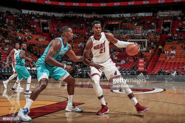 Hassan Whiteside of the Miami Heat handles the ball during the preseason game against the Charlotte Hornets on October 9 2017 at AmericanAirlines...