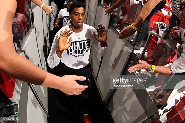 Hassan Whiteside of the Miami Heat high fives fans as he heads out to the court before the game against the Toronto Raptors in Game Three of the...