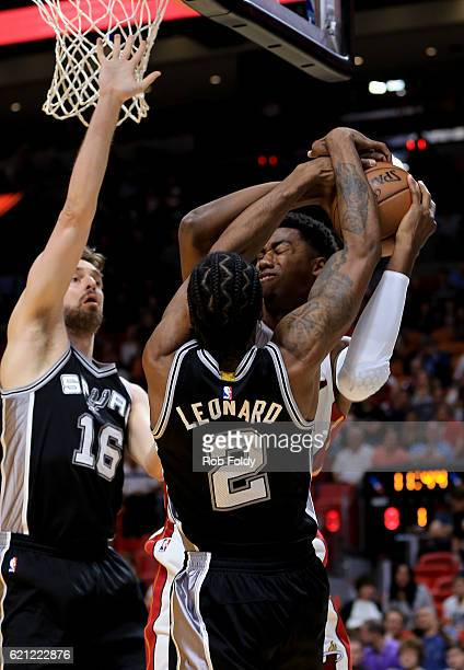 Hassan Whiteside of the Miami Heat in action against Kawhi Leonard and Pau Gasol of the San Antonio Spurs during the game at American Airlines Arena...