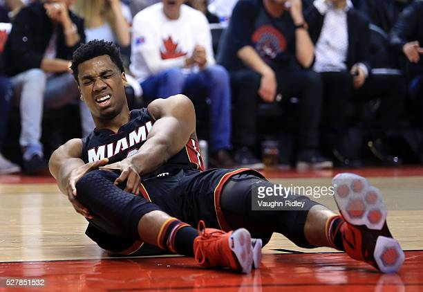Hassan Whiteside of the Miami Heat injures his knee in the first half of Game One of the Eastern Conference Semifinals against the Toronto Raptors...