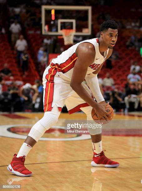 Hassan Whiteside of the Miami Heat looks to pass during a preseason game against the Charlotte Hornets at American Airlines Arena on October 9 2017...