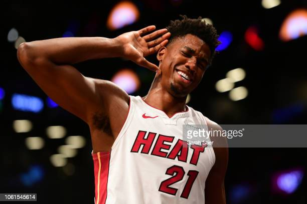 Hassan Whiteside of the Miami Heat motions for the fans to get louder during the final moments of the game against Brooklyn Nets at Barclays Center...