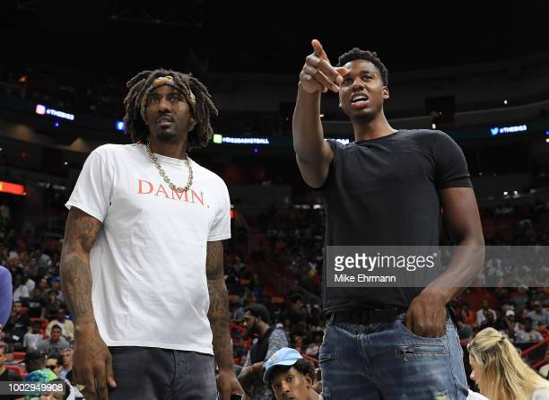 Hassan Whiteside of the Miami Heat points as Amar'e Stoudemire of Tri State looks on as they watch one of the games during Big 3Week Five at American...