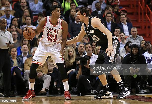 Hassan Whiteside of the Miami Heat posts up Boban Marjanovic of the San Antonio Spurs during a game at American Airlines Arena on February 9 2016 in...