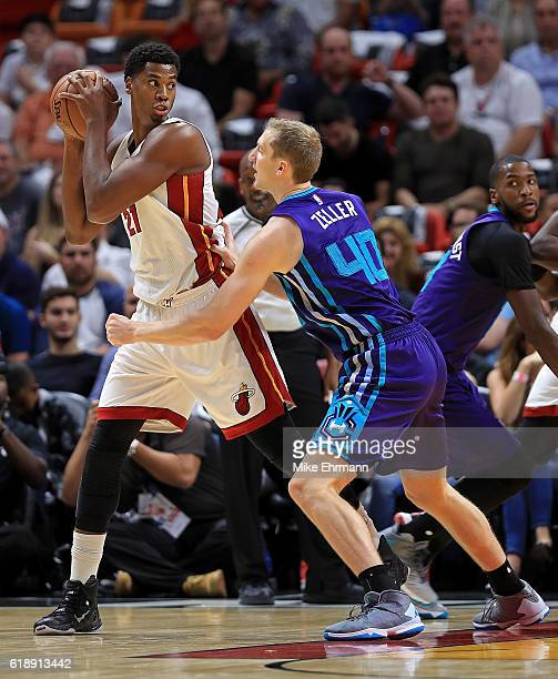 Hassan Whiteside of the Miami Heat posts up Cody Zeller of the Charlotte Hornets during a game at American Airlines Arena on October 28 2016 in Miami...