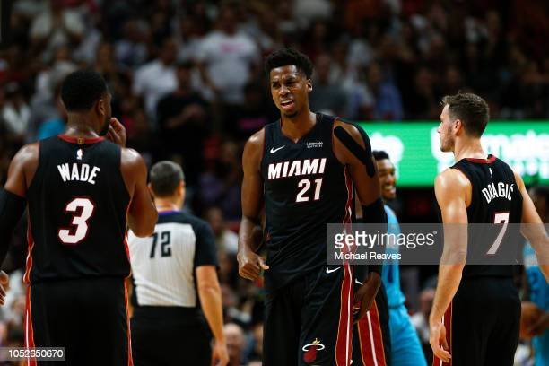 Hassan Whiteside of the Miami Heat reacts against the Charlotte Hornets during the second half at American Airlines Arena on October 20 2018 in Miami...
