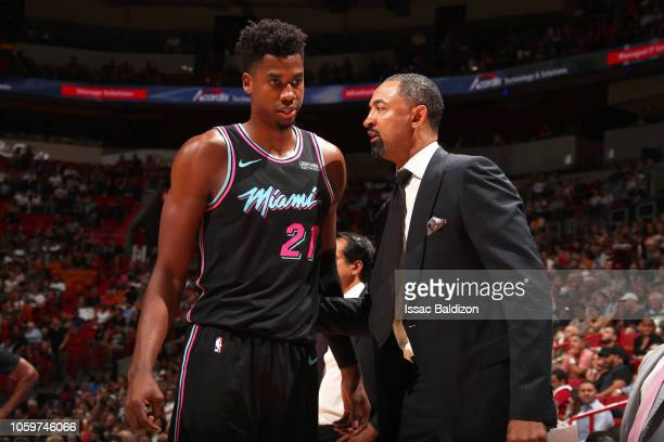 Hassan Whiteside of the Miami Heat speaks with Assistant Coach Juwan Howard of the Miami Heat during the game against the Indiana Pacers on November...