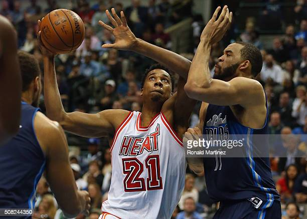 Hassan Whiteside of the Miami Heat takes a shot against JaVale McGee of the Dallas Mavericks in the first half at American Airlines Center on...