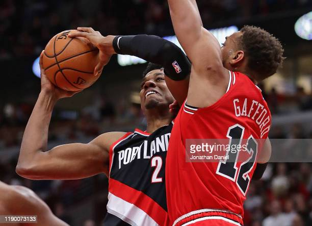 Hassan Whiteside of the Portland Trail Blazers tries to get off a shot against Daniel Gafford of the Chicago Bulls at United Center on November 25,...