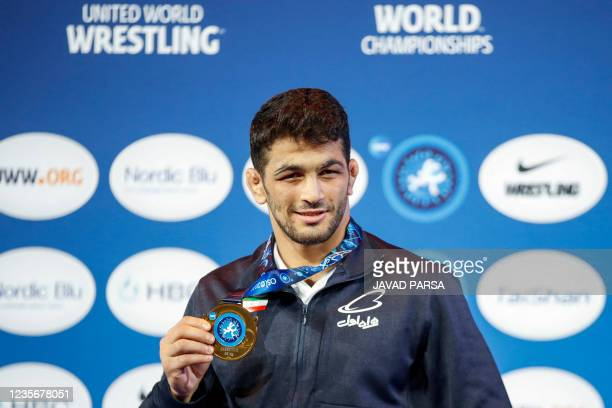 Hassan Yazdani Charati from Iran poses on the podium during the medals ceremony for the 2021 World Wrestling Championships on October 3, 2021. -...