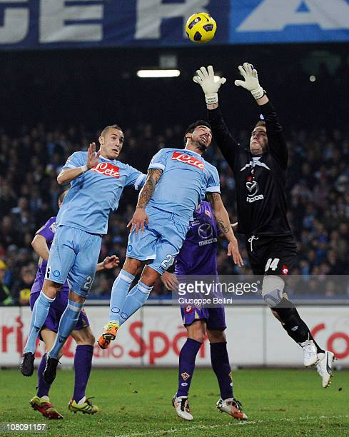 Hassan Yebda and Ezequiel Lavezzi of Napoli and Artur Boruc of Fiorentina in action during the Serie A match between Napoli and Fiorentina at Stadio...