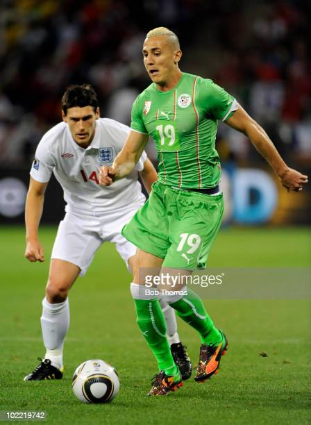 Hassan Yebda of Algeria watched by Gareth Barry of England during the 2010 FIFA World Cup South Africa Group C match between England and Algeria at...