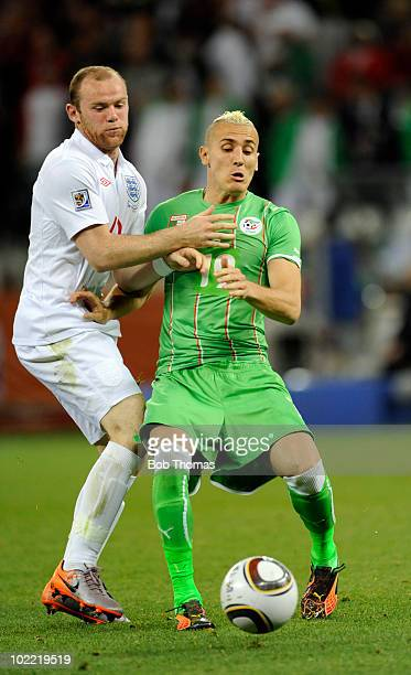 Hassan Yebda of Algeria with Wayne Rooney of England during the 2010 FIFA World Cup South Africa Group C match between England and Algeria at Green...