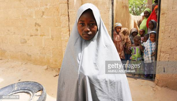 TOPSHOT Hassana Mohammed who scaled a fence to escape an alleged Boko Haram attack on her Government Girls Science and Technical College stands...