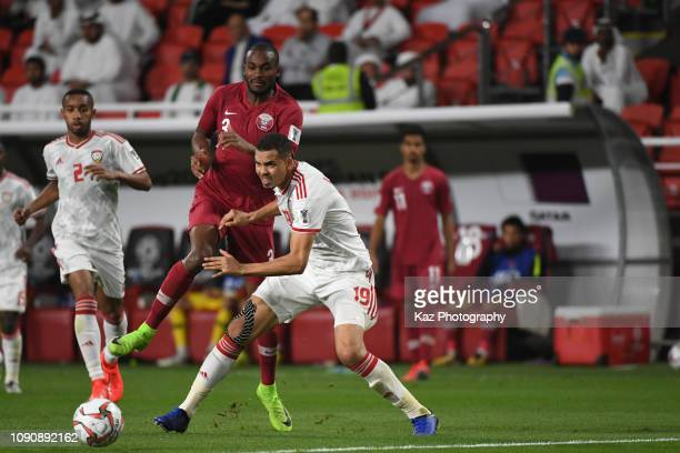 HassanAbdelkarim of Qatar and Mohamed Ismal Ahmed of United Arab Emirates compete for the ball during the AFC Asian Cup semi final match between...