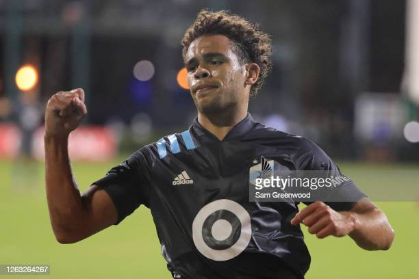 Hassani Dotson of Minnesota United celebrates after assisting Marlon Hairston for the fourth goal of their team during a quarter final match of MLS...