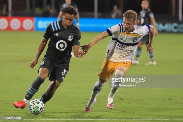 Hassani Dotson of Minnesota United controls the ball during a quarter final match of MLS Is Back Tournament between San Jose Earthquakes and...