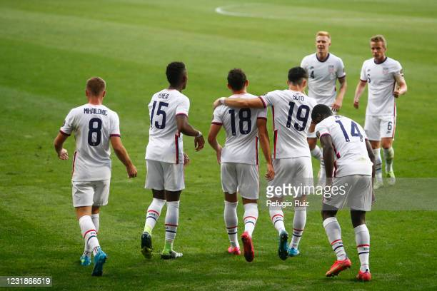 Hassani Dotson of United States celebrates with teammates the third team goal against the Dominican Republic in 2020 Concacaf Men's Olympic...