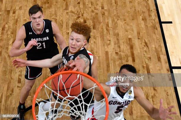 Hassani Gravett of the South Carolina Gamecocks denies Nigel WilliamsGoss of the Gonzaga Bulldogs during the 2017 NCAA Men's Final Four Semifinal at...