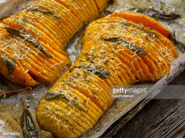 hasselback butternut squash with brown butter, sage and parmesan - canadian thanksgiving stock pictures, royalty-free photos & images