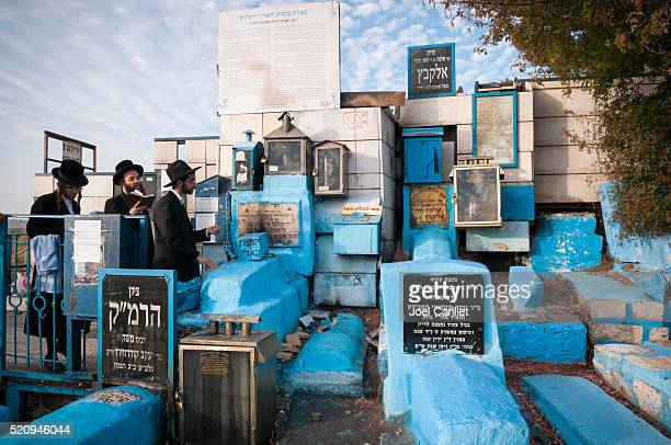 hassidic jews praying at rabbi isaac luria grave in safed - safed stock photos and pictures