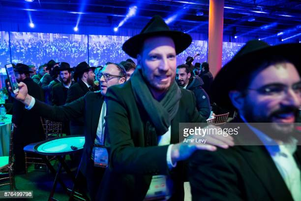 Hassidic rabbis and guests from around the world dance during the ChabadLubavitch annual dinner on November 19 2017 in Bayonne New Jersey More than...