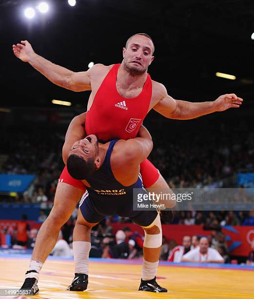 Hassine Ayari of Tunisia is thrown by Choukri Atafi of Morocco during their Men's Greco-Roman 96kg 1/8 Final on Day 11 of the London 2012 Olympic...