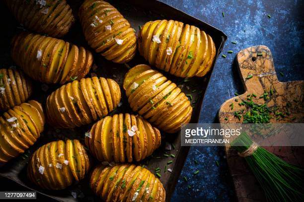hassleback potatoes sliced potato oven roasted salt and chive - prepared potato stock pictures, royalty-free photos & images