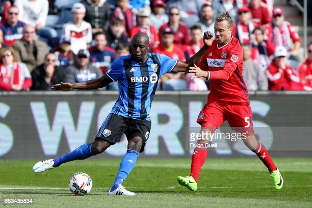 Hassoun Camara of Montreal Impact clears the ball while being defended by Michael Harrington of Chicago Fire in the second half during an MLS match...