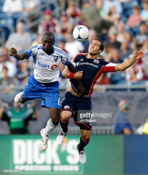 Hassoun Camara of the Montreal Impact heads the ball towards the nets as A.J. Soares of the New England Revolution defends at Gillette Stadium on...