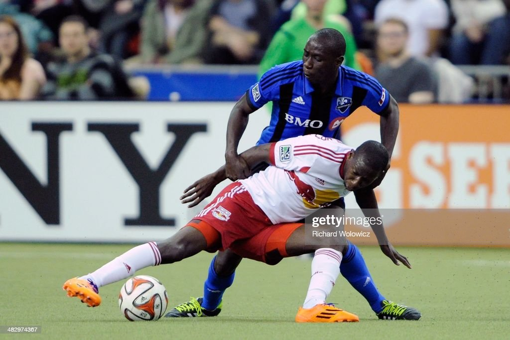 Hassoun Camara #6 of the Montreal Impact holds onto Bradley Wright-Phillips #99 of the New York RedBulls during the MLS game at the Olympic Stadium on April 5, 2014 in Montreal, Quebec, Canada.