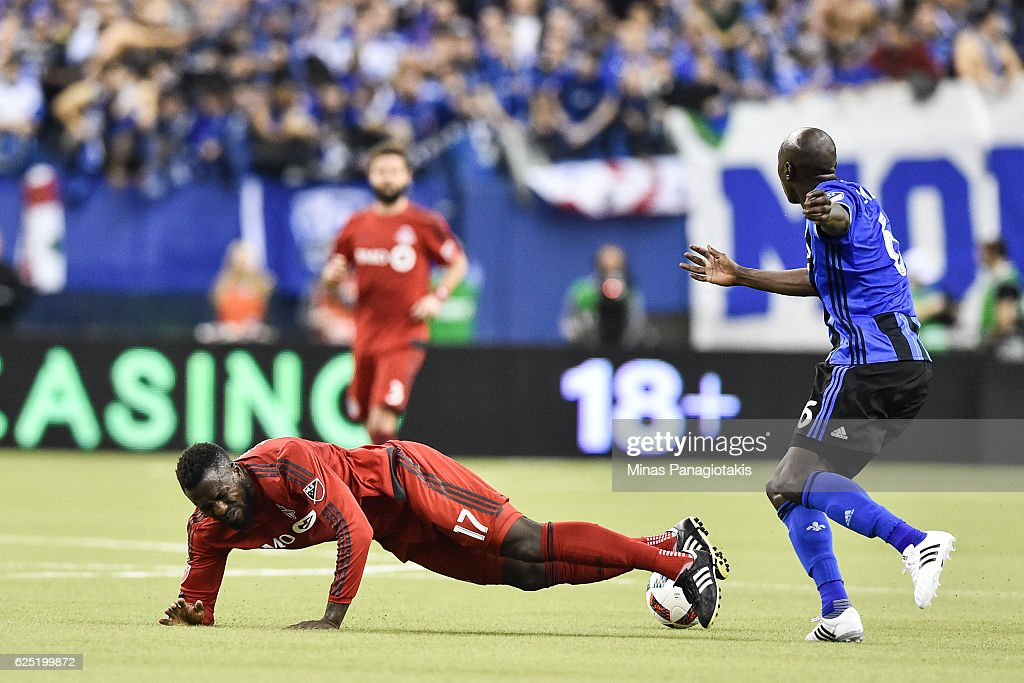 Hassoun Camara #6 of the Montreal Impact takes down Jozy Altidore #17 of the Toronto FC during leg one of the MLS Eastern Conference finals at Olympic Stadium on November 22, 2016 in Montreal, Quebec, Canada. The Montreal Impact defeated the Toronto FC