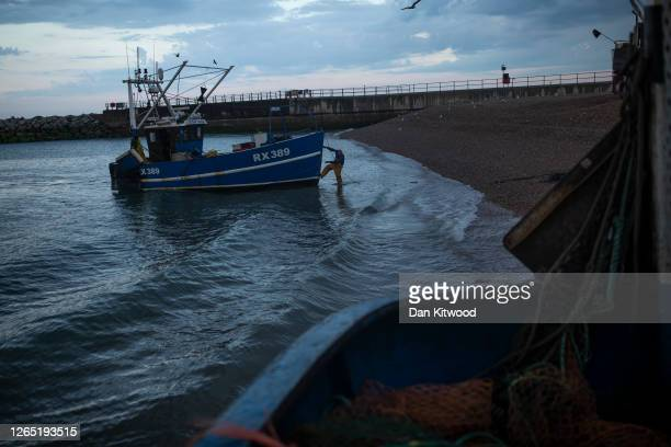 Hastings fishing boat returns from the English Channel on August 10, 2020 in Hastings, England. For coastal communities around the UK, the fishing...