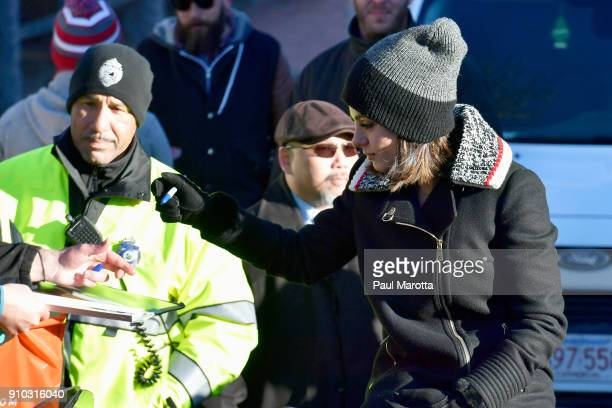 Actor Mila Kunis signs autographs during the parade for Hasty Pudding Theatricals Honors Mila Kunis as 2018 Woman Of The Year on January 25 2018 in...