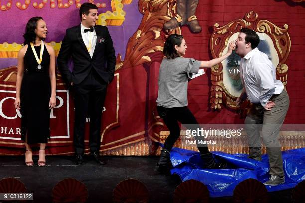 Actor Mila Kunis throws donuts at a Harvard University student during Hasty Pudding Theatricals Honors Mila Kunis as 2018 Woman Of The Year on...