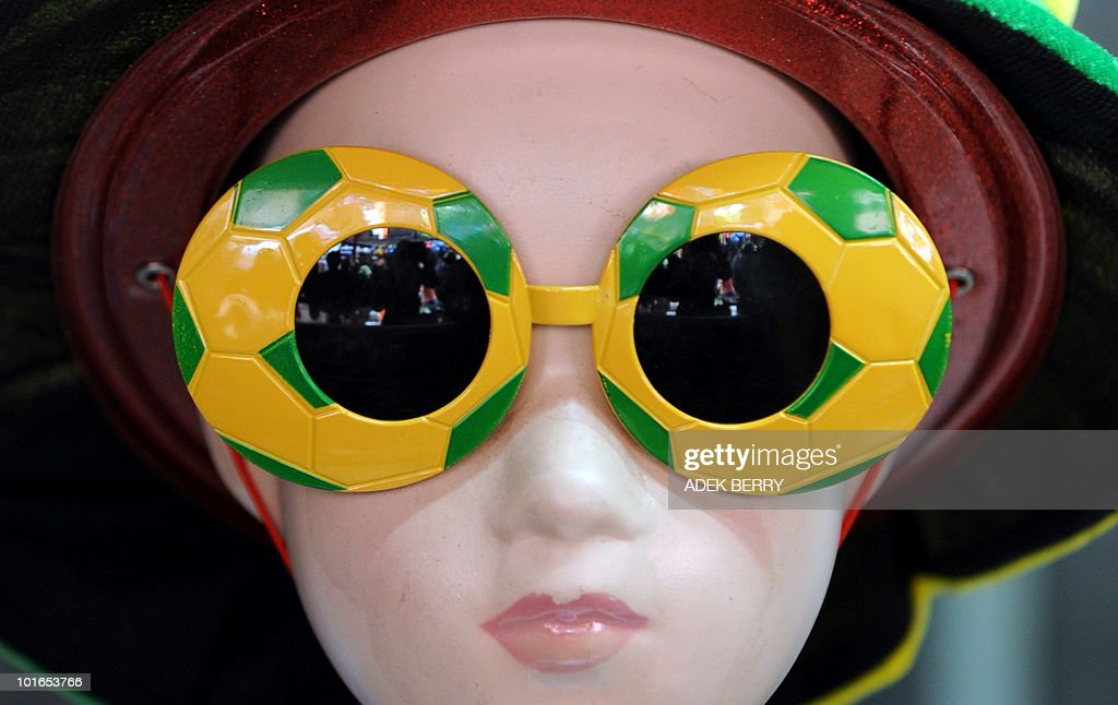A hat and a pair of sunglasses shaped like footballs stand on display in a shop in Jakarta on June 6, 2010 for the 2010 World Cup football tournament in South Africa.