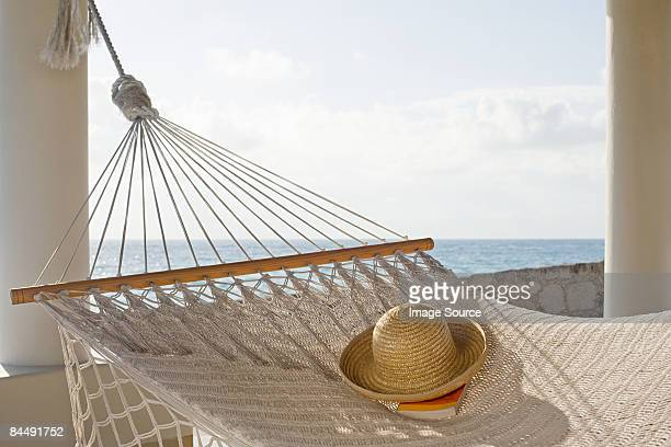Hat and book on hammock