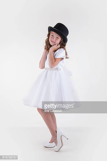 hat and shoes - little girl in high heels stock photos and pictures
