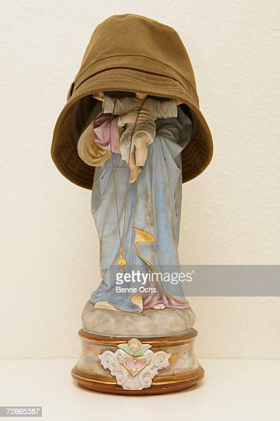 Hat covering figurine of Jesus and the Virgin Mary