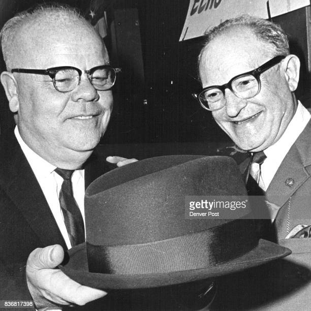 Hat From ' Oldtimers ' Paul A. Yetter, left, vice president in charge of public relations for the Public Service Co. Of Colorado, receives a hat from...