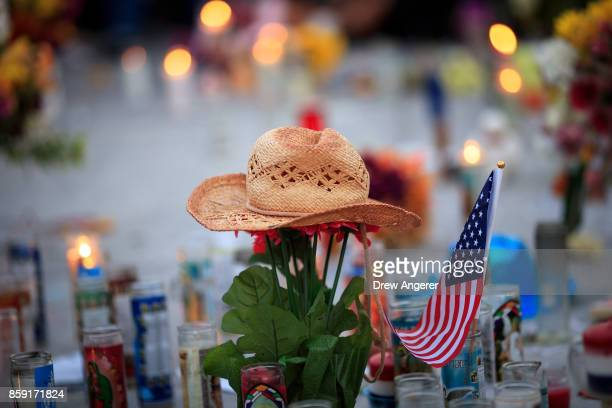 A hat is left at a makeshift memorial during a vigil to mark one week since the mass shooting at the Route 91 Harvest country music festival on the...