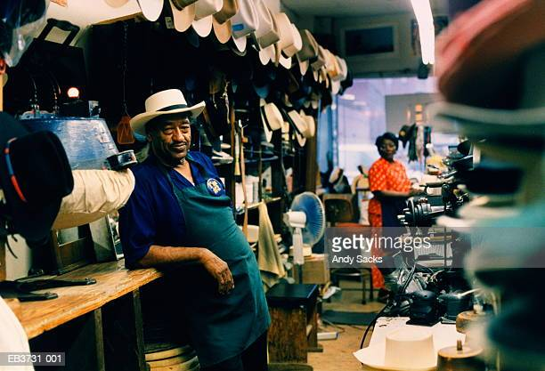 hat maker in his shop, wife in background, tennessee, usa - tennessee stock pictures, royalty-free photos & images