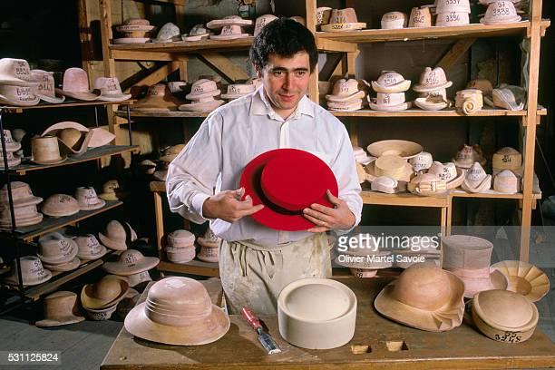 Hat Maker Showing Wares