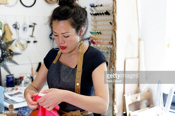 hat maker working in her studio - earring stock pictures, royalty-free photos & images
