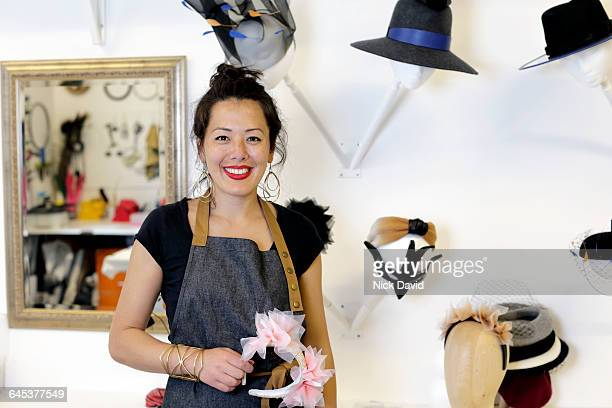 hat maker working in her studio - mixed race person stock pictures, royalty-free photos & images